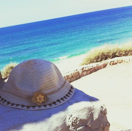 Beach Sand Sea Water Shore Horizon Over Water Beauty In Nature Nature Tranquil Scene Scenics Day Sunlight Outdoors Vacations Summer Tranquility No People Clear Sky Wave Hat Strawhat Woman Woman Hat Women Hat Mysterious Break The Mold BYOPaper! Live For The Story