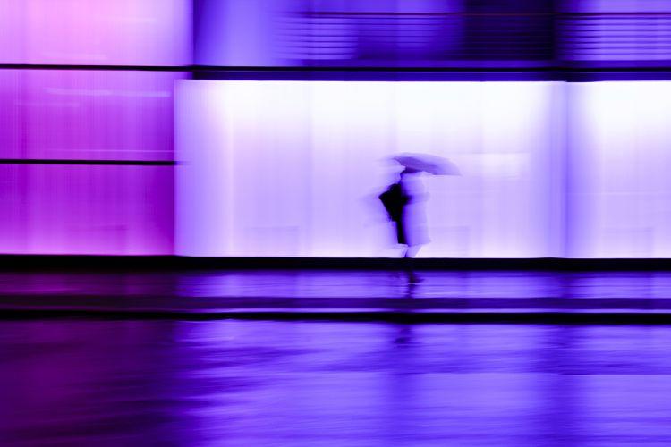 Side view of woman walking on illuminated floor