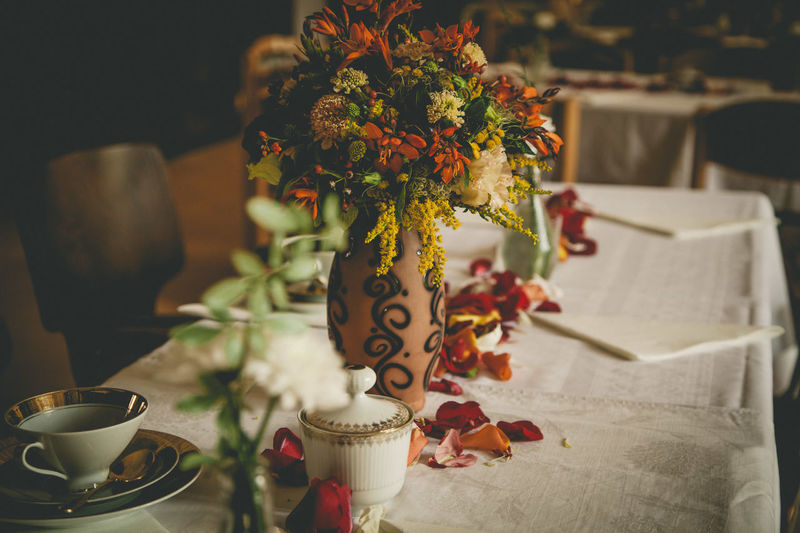 Close-up of flower vase on decorated table