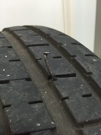Close-up Damage Damaged Flat Tyre Hole Man Made Object Nail In Tyre Nails Puncture Puncture Repair Relaxing Rubber Tyre Tyre Repair Wheel