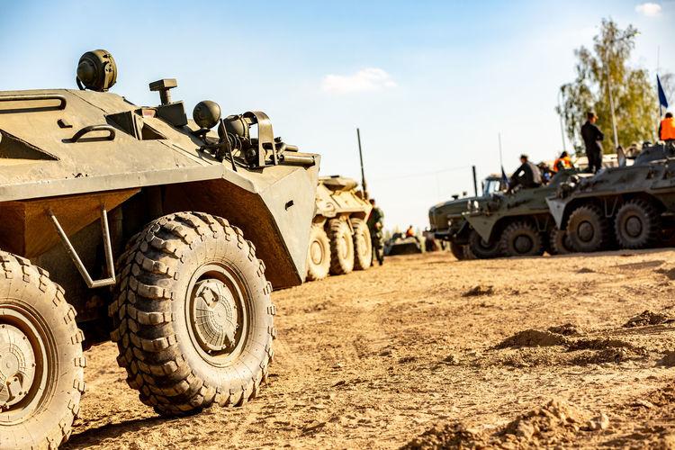 Tank on field against sky