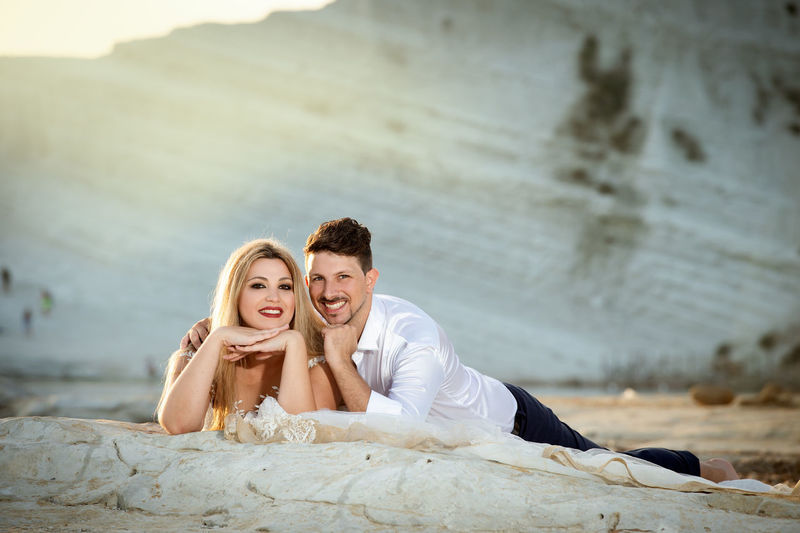Adult Beautiful Woman Bonding Couple - Relationship Emotion Happiness Heterosexual Couple Love Men Outdoors People Portrait Positive Emotion Sitting Smiling Togetherness Two People Wife Women Young Adult Young Men Young Women