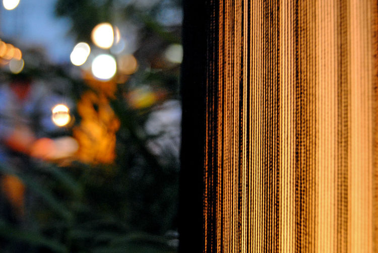 Cropped Image Of Electric Lamp In Restaurant