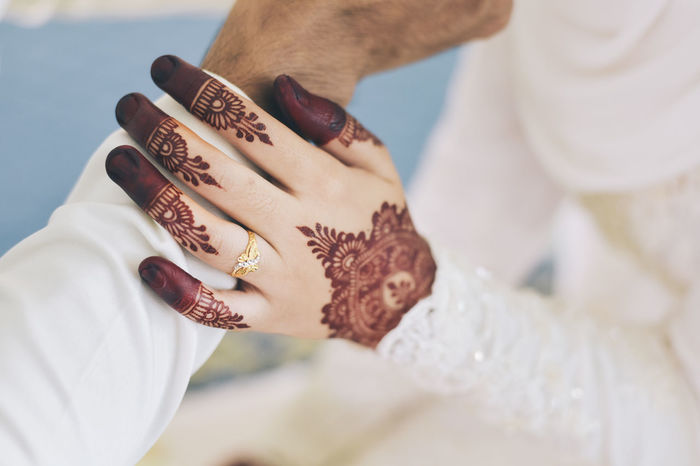 Gold ring on bride hand with henna. Wedding concept Human Hand People Indoors  Holding Day Bride Wedding Concept Marriage  Love Ocasion Celebration Ring Gold Fashion Accessory Event Malaysian Bride And Groom Couple Relationship Married Henna Women Culture