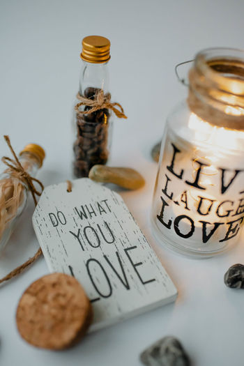 High angle view of text in glass jar on table