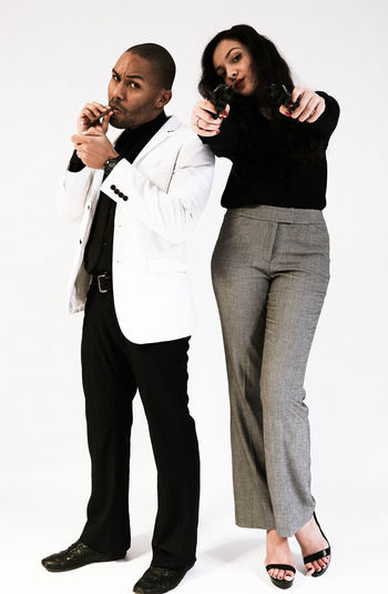 Portrait of fashionable gangster friends against white background