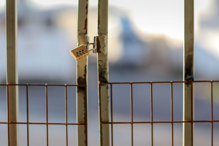 Close-Up Of Locked Metallic Gate