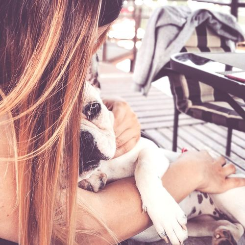 Pets Dog One Animal Domestic Animals One Person Sitting Adult Mammal People Only Women One Woman Only Women Day Adults Only Relaxation Outdoors Human Body Part Young Adult One Young Woman Only Close-up Hair