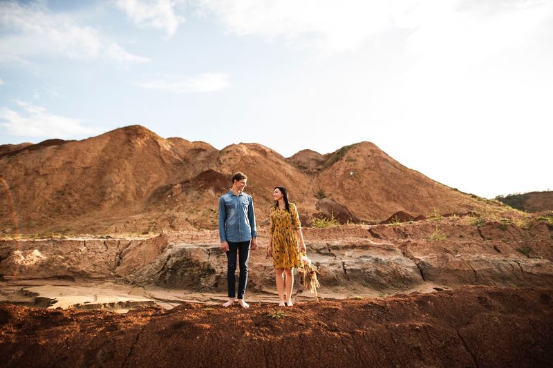 Full Length Men Standing Leisure Activity Lifestyles Scenics - Nature Nature People Day Bonding Non-urban Scene Two People Mountain Beauty In Nature Rear View Casual Clothing Land Togetherness
