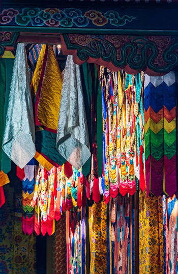 Multi colored textile hanging at market stall