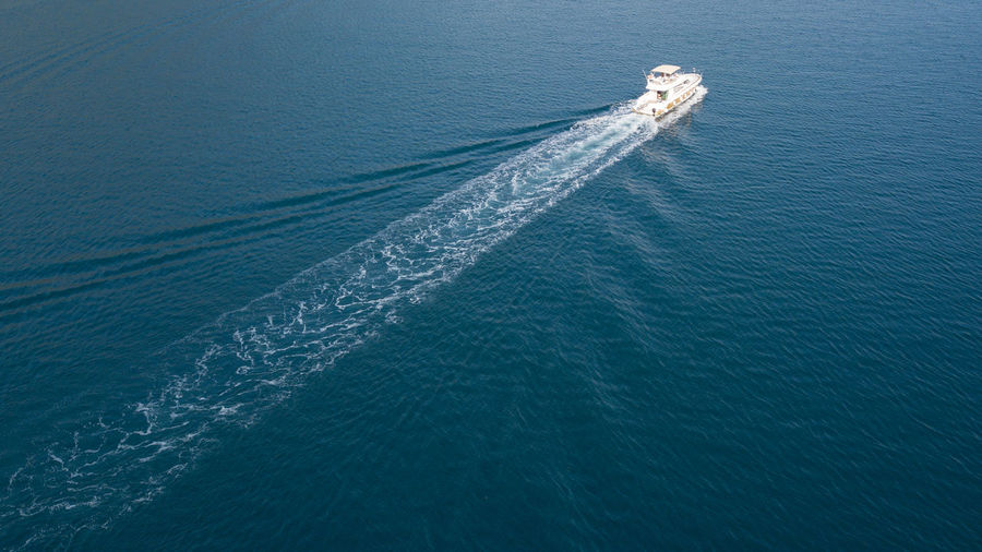 aerial view of luxury boat Aerial View Blue Boat Cruise Day Engine Expensive Fast Journey Luxury Motion Motorboat Nature Nautical Vessel No People on the move Outdoors Sea Speed Trail Transportation Turquoise Water Waterfront Yacht
