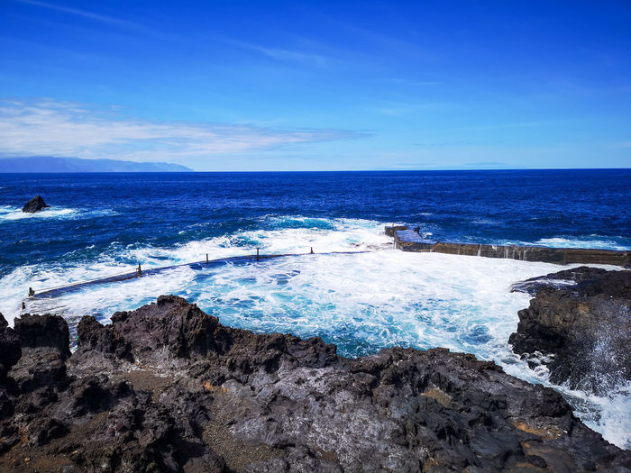 Wanderlust Solotraveler Vacations Winter EyeEm Tenerife EyeEm Selects Travel Destinations No People Moments Blue Blue Sky Nature Beauty In Nature Perfect Day Water Wave Sea Beach Blue Sand Sky Horizon Over Water Surf Coast Rocky Coastline Seashore Seascape Rushing Crashing