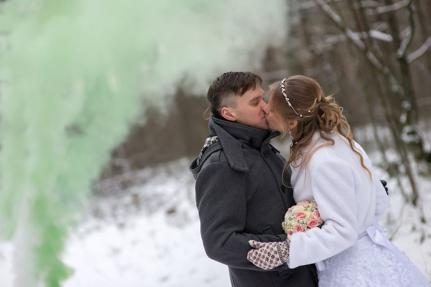 Blond Hair Bonding Close-up Cold Temperature Day Embracing Focus On Foreground Green Smoke Happiness Holding Leisure Activity Love Men Nature Outdoors Real People Romance Standing Togetherness Two People Warm Clothing Winter Women Young Adult Young Women