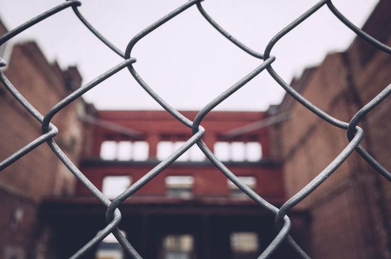 Full frame shot of chainlink fence against building