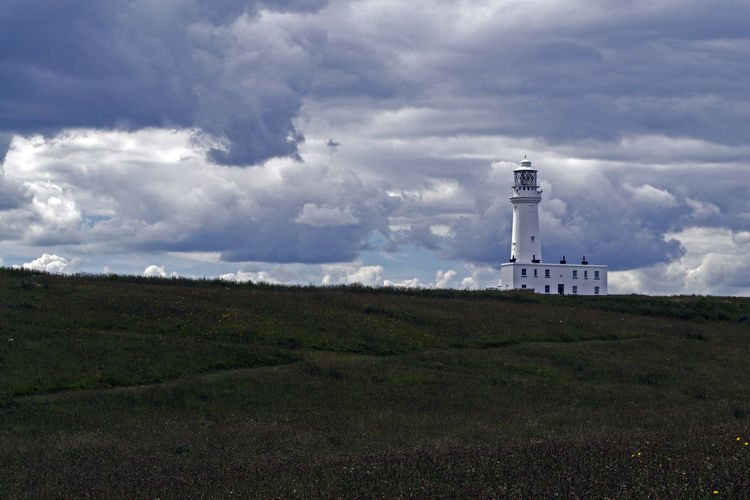Flamborough Lighthouse Moody Sky Serenity Stormy Weather Tranquility Architecture Beauty In Nature Built Structure Cloud - Sky Day Direction Field Flamborough Head Grass Guidance Landscape Lighthouse Moody Nature No People Outdoors Sky Stormy Sky Tranquil Scene
