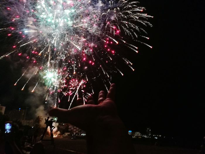Celebration Firework Display Night Exploding Event Multi Colored Human Hand Low Angle View Fireworksphotography Fireworks In My Hand