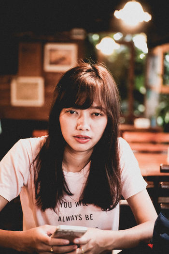what do you see ? my love. Bangs Beautiful Woman Casual Clothing Focus On Foreground Front View Hairstyle Indoors  Leisure Activity Lifestyles Looking At Camera One Person Portrait Real People Restaurant Sitting Table Teenager Waist Up Women Young Adult Young Women