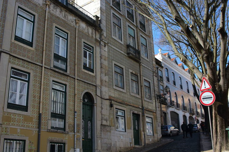 Streets Of Lisbon EyeEm City Lover Lisboa Portugal Lisbon - Portugal Lissabon, Portugal Building Exterior Architecture Built Structure City Building Window Street Tree Residential District Day Plant Incidental People Road Sign City Life Outdoors