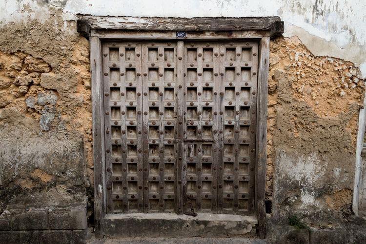 Architecture Closed Day Door Door Frame Doorway Frame Heavy No People Street Tanzania Texture Wooden Wooden Door Zanzibar Zanzibar Doors