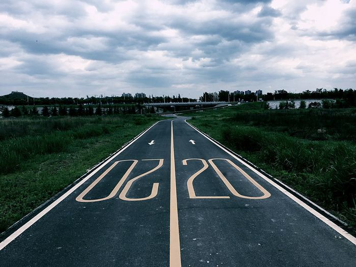 High angle view of number on road by field
