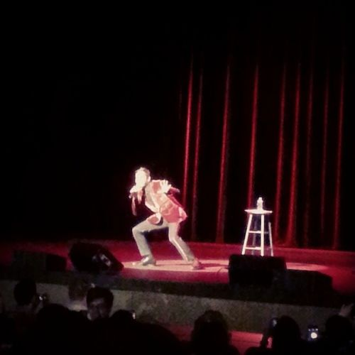 Blurry picture from a comedy show Azizansari Tpac