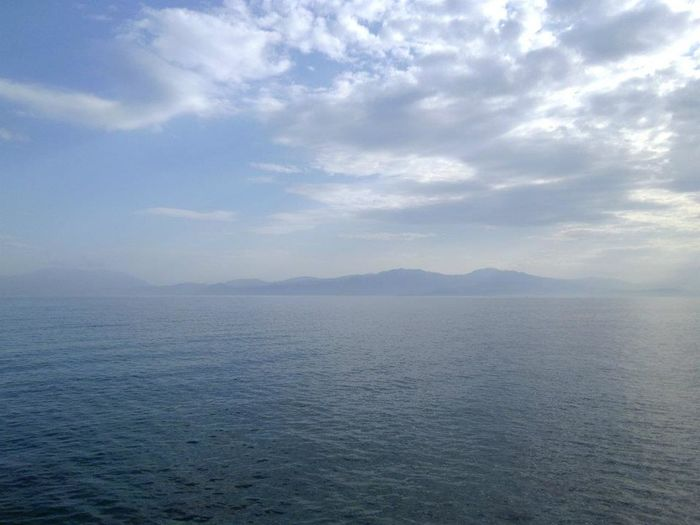 Beauty In Nature Blue Calm Distant Endlessness Enslessness Eternal Eternity Idyllic Majestic Mountain Range Nature Scenics Sea Seascape Sky Tranquil Scene Tranquility Travel Destinations Water