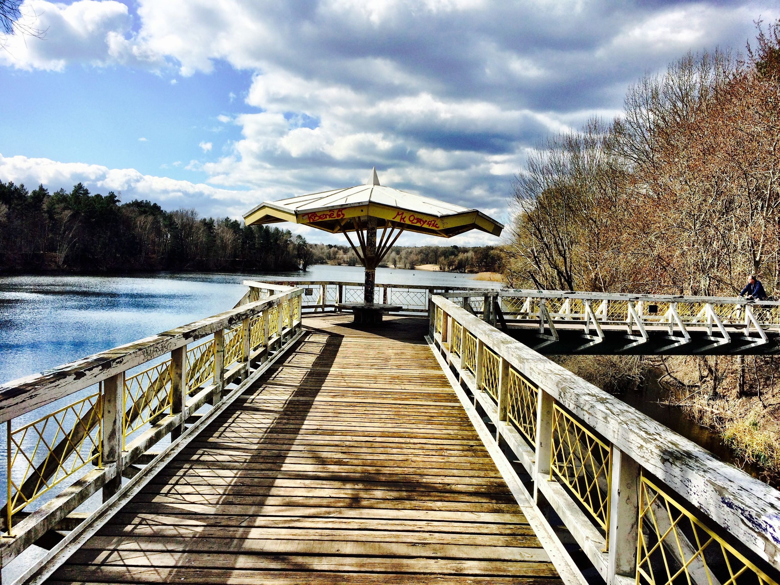 the way forward, railing, sky, water, tranquility, pier, wood - material, built structure, tranquil scene, tree, cloud - sky, diminishing perspective, footbridge, scenics, boardwalk, nature, beauty in nature, lake, architecture, wood