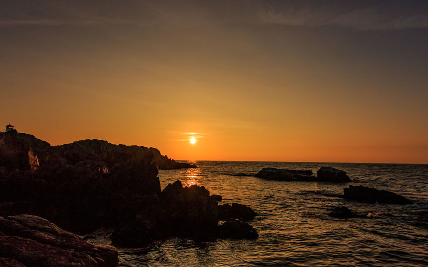 Rock oragne EyeEmNewHere Beauty In Nature Horizon Over Water Kullaberg Nature No People Orange Color Outdoors Rock - Object Scenics Sea Sky Sun Sunset Tranquil Scene Tranquility Water