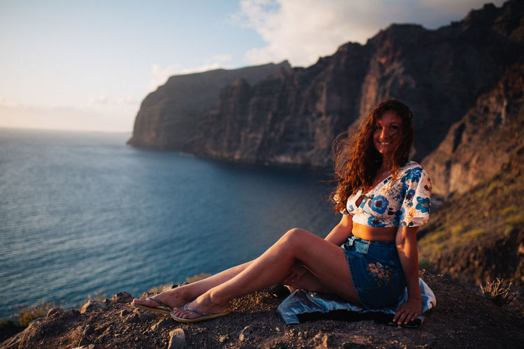 Los Gigantes cliffs - Tenerife Adult Beautiful Woman Beauty In Nature Casual Clothing Full Length Hair Hairstyle Land Leisure Activity Lifestyle Photography Mountain Nature Outdoors Rock Rock - Object Scenics - Nature Sea Sitting Sky Solid Tenerife Water Women Young Adult Young Women