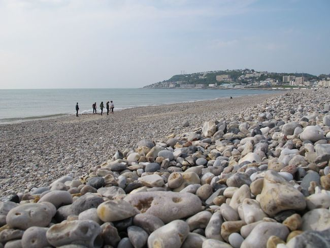 A beach at Le Havre Le Havre Beach Beauty In Nature Clear Sky Day Horizon Over Water Leisure Activity Lifestyles Men Nature Outdoors Pebble Pebble Beach People Real People Sand Scenics Sea Shore Sky Standing Water Women