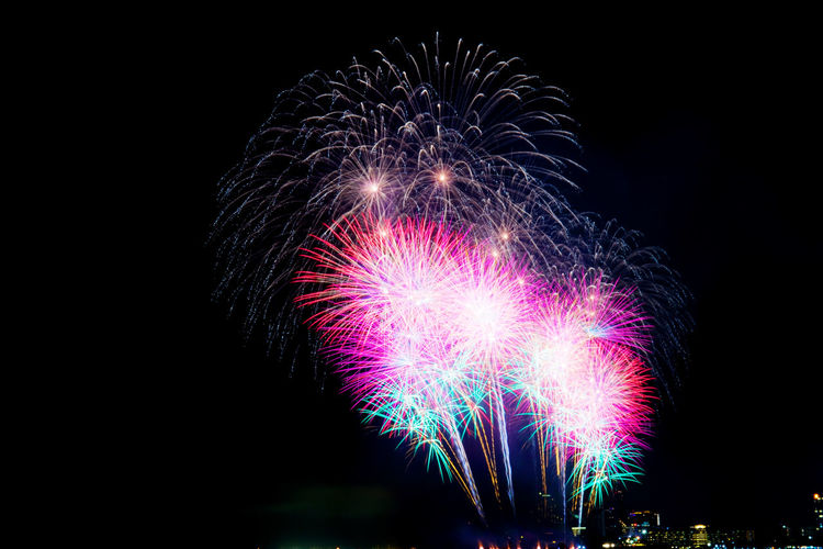 Fireworks in the sky with beautiful of colors. Amazing Anniversary ASIA Asian  Background Beach Beautiful Beauty Black Bright Celebrate Celebration Color Colorful Dark Display Dramatic Event Explosion Festival Festive Fire Firework Fireworks Happy Holiday Isolated Light Nature New Night Outdoors Party Relax River Scene Sea Show Sky Space Stage Year Sunset Thai Thailand Vibrant View Water Weather Year