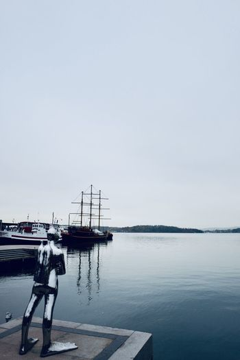 Water Sky Sea Nautical Vessel Transportation Pier Mode Of Transportation Nature Copy Space Reflection Day Tranquility Beauty In Nature Outdoors Tranquil Scene Scenics - Nature Harbor Architecture Moored No People