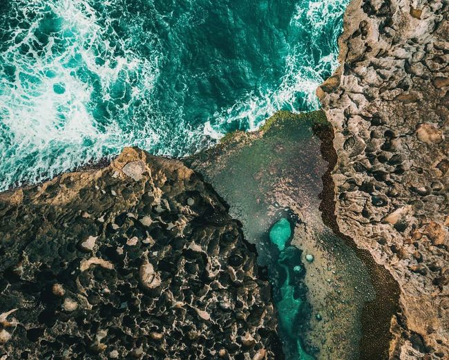 EyeEm Nature Lover Aquatic Sport Beach Beauty In Nature Breaking Day First Eyeem Photo High Angle View Land Motion Nature Nature_collection No People Outdoors Power In Nature Rock Rock - Object Rock Formation Rocky Coastline Sea Solid Sport Turquoise Colored Water Wave Summer Exploratorium
