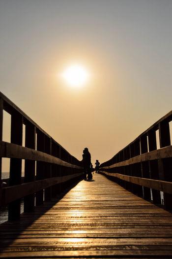 Footbridge Clear Sky Sunset Water Bridge - Man Made Structure Beach Sunlight Silhouette Full Length Sun Ocean Scenics