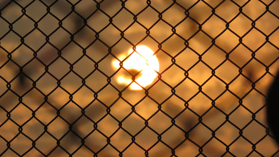Caged Sun Wintertime Winter Theme Lahore Bixbite Studio Caged Cage Natural Colours Natural Colors Colorful Nature Photography Winter Sunset Winter Sky Winter Sun Winter No People Sky Sun Sunset Nature Pakistan