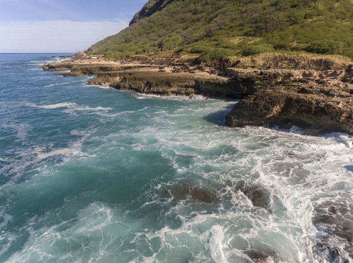 Aerial view of the coast of Oahu Hawaii Kaena Point Oahu, Hawaii View Aerial Beach Beauty In Nature Day Hawaiian Islands Motion Nature No People Ocean Outdoors Rock Rock - Object Rocky Coastline Scenics - Nature Sea Seascape Sky Tranquil Scene Tranquility Travel Destinations Water Wave