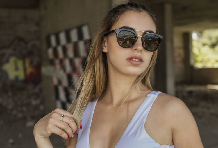 Glasses One Person Focus On Foreground Real People Young Adult Portrait Lifestyles Front View Young Women Leisure Activity Sunglasses Long Hair Headshot Fashion Hairstyle Women Beautiful Woman Day Hair Teenager