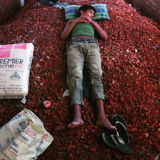 A young construction worker having a quick nap after lunch in a site during scorching heat in Chittagong ! 30.05.2015 Js Jashimsalam Photographer Photojournalist Documentary Dailylife Work Workers Construction Labour Urbanlivingfs Summer Heat Wave Hot Warm Instagram Nap Sleep Concreat Chittagong Chottogram Everydaybangladesh