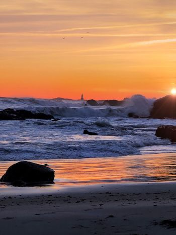 Sunset Sea Sky Water Beach Orange Color Scenics - Nature Non-urban Scene Idyllic No People Rock Tranquil Scene Nature Wave Cloud - Sky Beauty In Nature Motion Tranquility Horizon Over Water Land