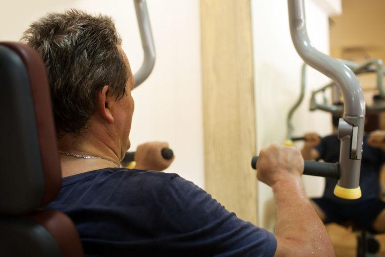 Mature man exercising at gym