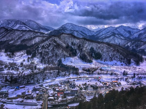 View on the valley below Yamadera temple in Yamagata prefecture Japan Japan YAMAGATA Yamadera Valley Winter Snow Mountain Mountains Mountains And Sky Mountain View Cloud Clouds Cloudscape Nature Scenics Beauty In Nature High Angle View Flying High Outdoors Sky Landscape Day Valley View