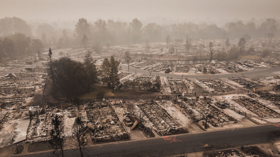 Wild fire destroys people's mobile homes and flips lives upside down after fire blows through town.