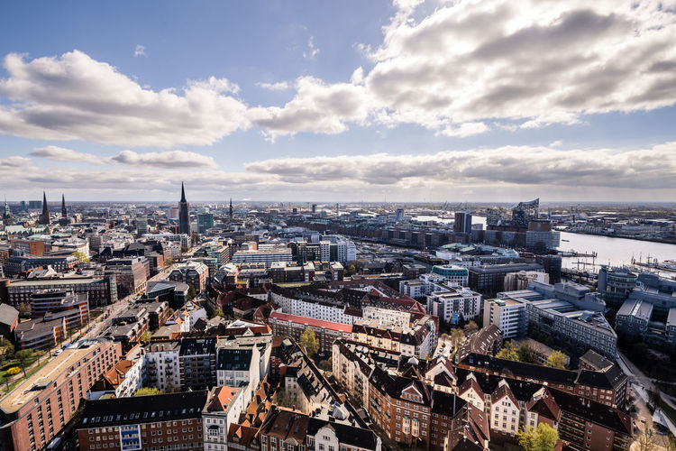 High Angle View Of Hamburg Cityscape Against Cloudy Sky