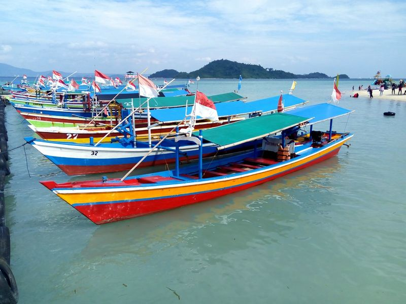 Sea Beach Water Nautical Vessel Tourism Sand Vacations Travel Pier Transportation Travel Destinations Tranquility Summer Cloud - Sky Day INDONESIA relaxation Nature Outdoors Harbor Horizon Over Water