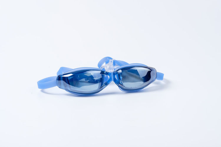 Blue Clean Equipment Glossy Goggle Goggles Rubber Swim Swimming Swimming Goggle White White Background Studio Shot Copy Space Indoors  Still Life Cut Out Close-up Love No People Emotion Ribbon Celebration Ring Ribbon - Sewing Item Two Objects Event Life Events Jewelry Single Object Silver Colored Luxury Personal Accessory