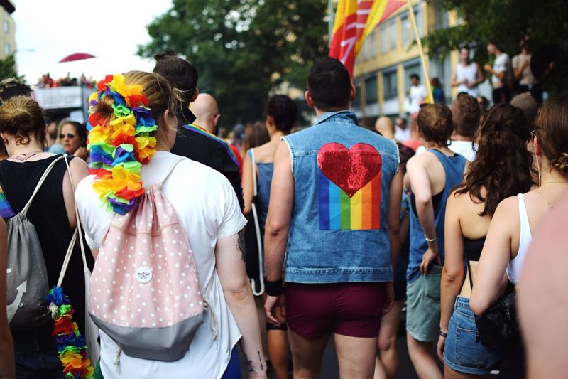 Presenting Berlin pride: #2 Parading. Messages of love and togetherness everywhere. I never feel as safe and belonging as at a pride parade and so many people are spreading the word of love and inclusion that anyone standing by is immediately enraptured. This jacket captures the whole spirit of a pride parade beautifully. Street Fashion CSD Love Is Love Pride EyeEm Selects Group Of People Real People City Large Group Of People Street Crowd Celebration Lifestyles Multi Colored Togetherness Event Outdoors Festival Flag Love Is Love The Street Photographer - 2018 EyeEm Awards