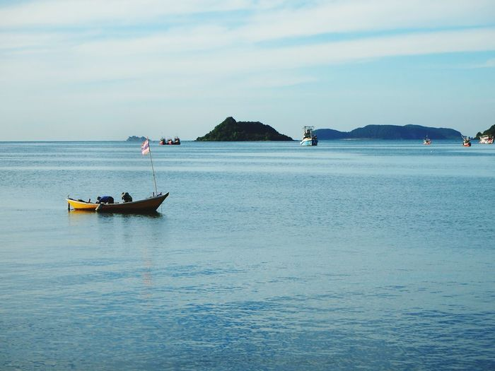 My first new year's photo : Jan 1st, 2019 – Fisher men had tried to start the boat motor in the sea. Life Photography Morning Thailand Winter New Year 2019 Fisherman Island Sea Water Beach Sky Landscape Fishing Boat Seascape Shore Coastline Fishing Industry Ocean