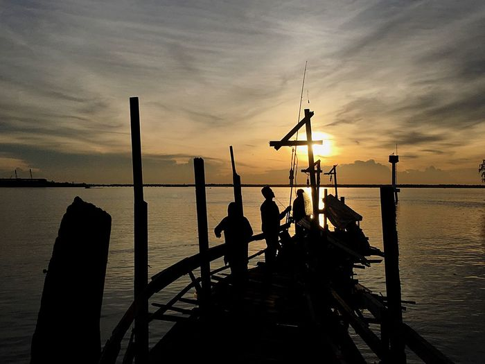 Malaysia Truly Asia Port Klang Sunset Fishing Sea And Sky Sea Silhouette Beauty In Nature Horizon Over Water Photooftheday Southeastasia Jetty Photographer Done That. Lost In The Landscape Connected By Travel Sunset Silhouettes Travel Destinations