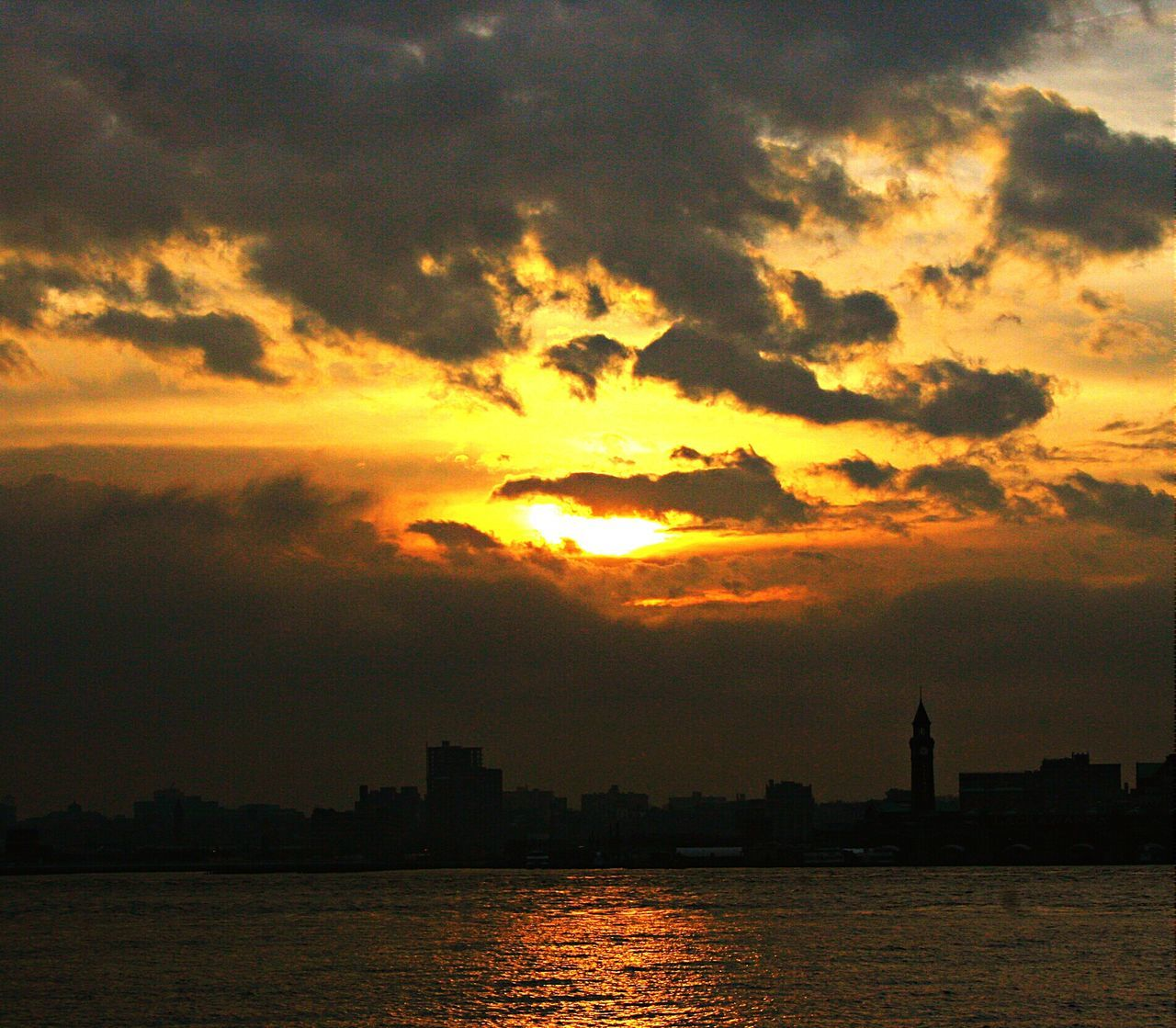 sunset, sky, cloud - sky, building exterior, architecture, city, water, cityscape, silhouette, sun, built structure, waterfront, river, nature, no people, beauty in nature, scenics, skyscraper, outdoors, travel destinations, urban skyline, day