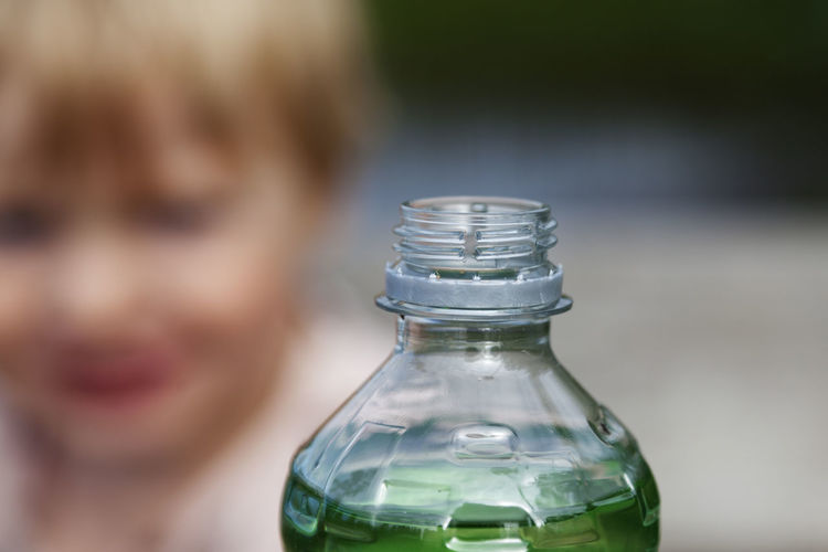 Close-up portrait of glass bottle